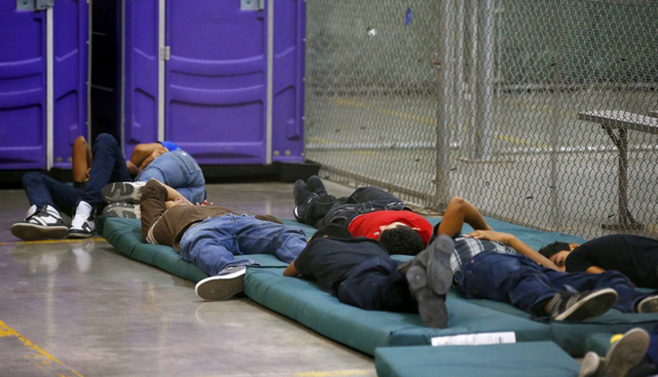 Young boys sleep in a holding cell where hundreds of mostly Central American immigrant children are being processed and held at the U.S. Customs and Border Protection Nogales Placement Center in Nogales