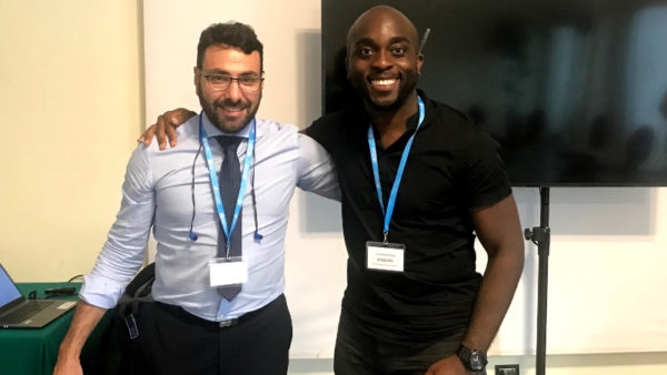 Emeka and classmate at WHO Summer School on Refugee and Migrant Health